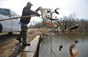 3.27.14- BALTIMORE, MD- Mark Staley, Central Maryland Fishery's Biologist, introduces Trout into the Gwynn Oak Pond in Baltimore City by tossing them from one net at a time. (The Daily Record/Maximilian Franz)
