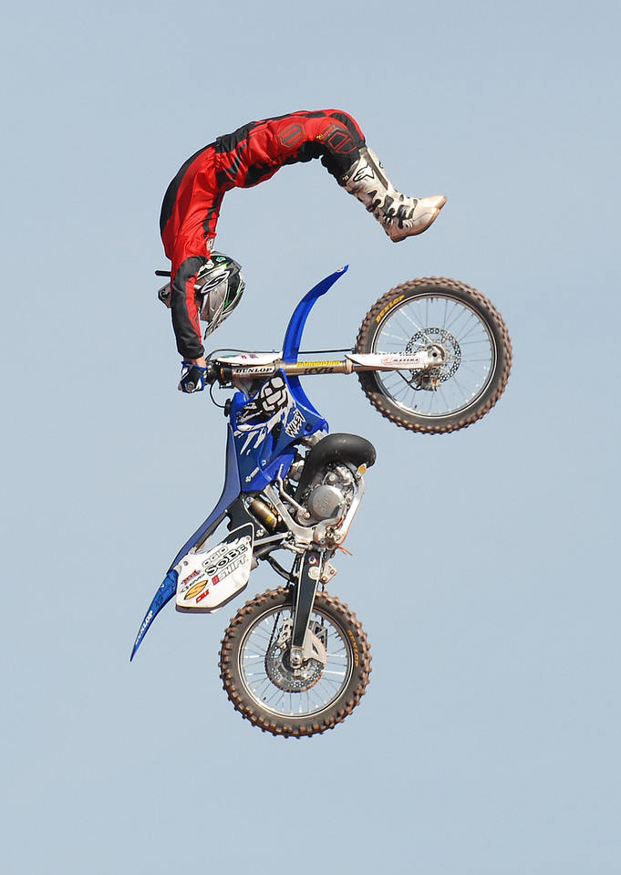 FMX stunt proformer does a backflip on his dirtbike during the first round warmups at the AST Dew Tour on June 23, 2007. Maximilian Franz/The Daily Record