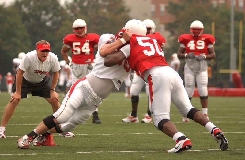 Teammates go at it during a defensive drill during a maryalnd Terps Practice Session on 8/17/04. Maximilian Franz/The Daily Record