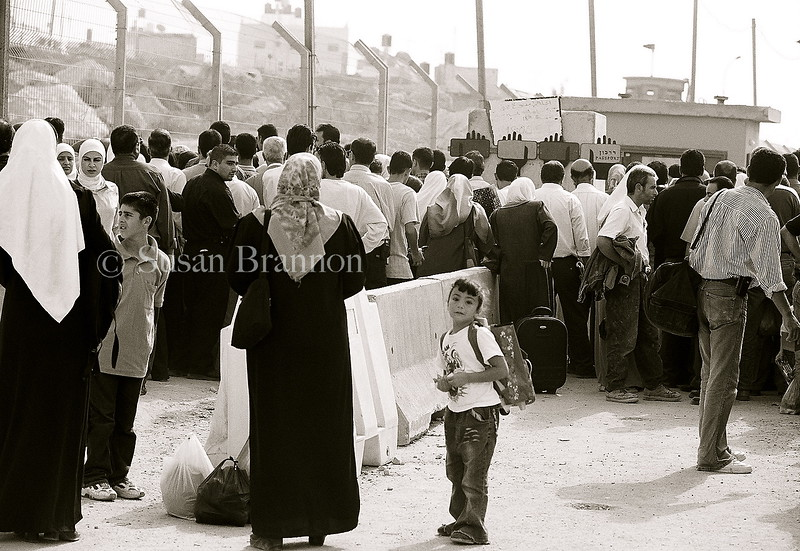 School girl waiting at the checkpoint crossing between Israel and Jerusalem to go to school.  The West Bank