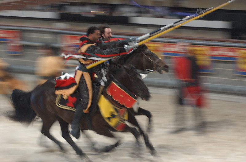 The Yellow Knight and the White Knight spear the same ring during the jousting matchup at Medieval Times. Maximilian Franz/The Daily Record