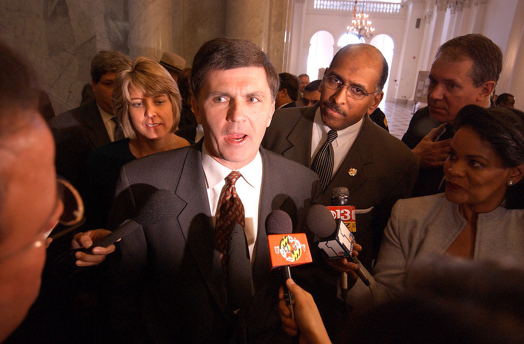Backed by his wife Kendel and Leutenant Governor Michael Steele, Governor Robert L. Ehrlich Jr. makes some comments to the media afther the opening of the Maryland General Assembley in 2004. Maximilian Franz/The Daily Record
