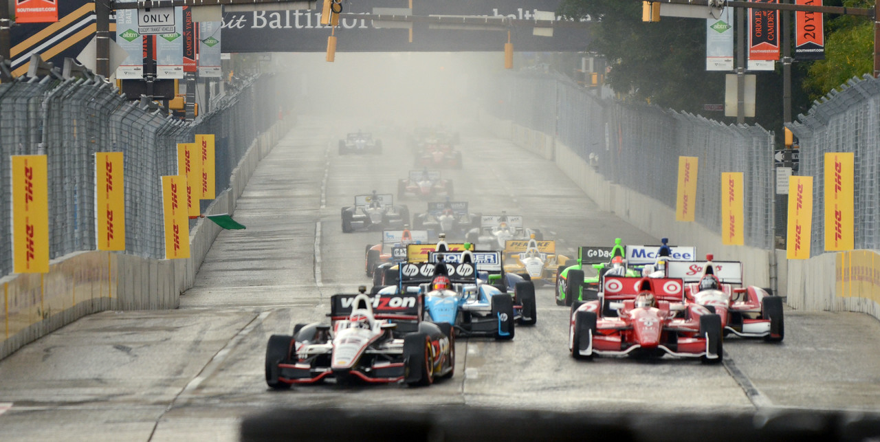 09.02.2012- Baltimore, MD- Indy cars race down Pratt Street through a light rain during the main race of the 2012 Baltimore Grand Prix. Maximilian Franz