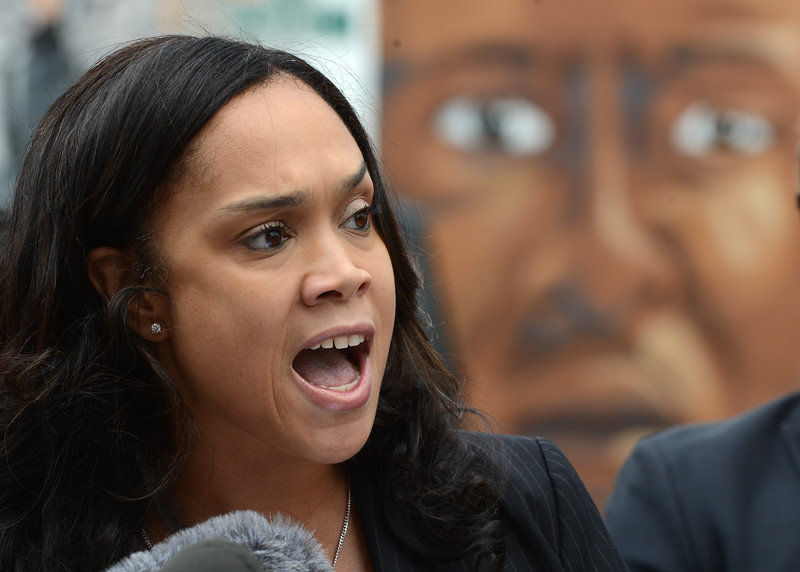 Baltimore City State's Attorney Marilyn J. Mosby addresses the media July 27 in west Baltimore, with a mural depicting Freddie Gray behind her, after charges were dropped against the three remaining officers charged in connection with Gray's death. (Maximilian Franz/The Daily Record)