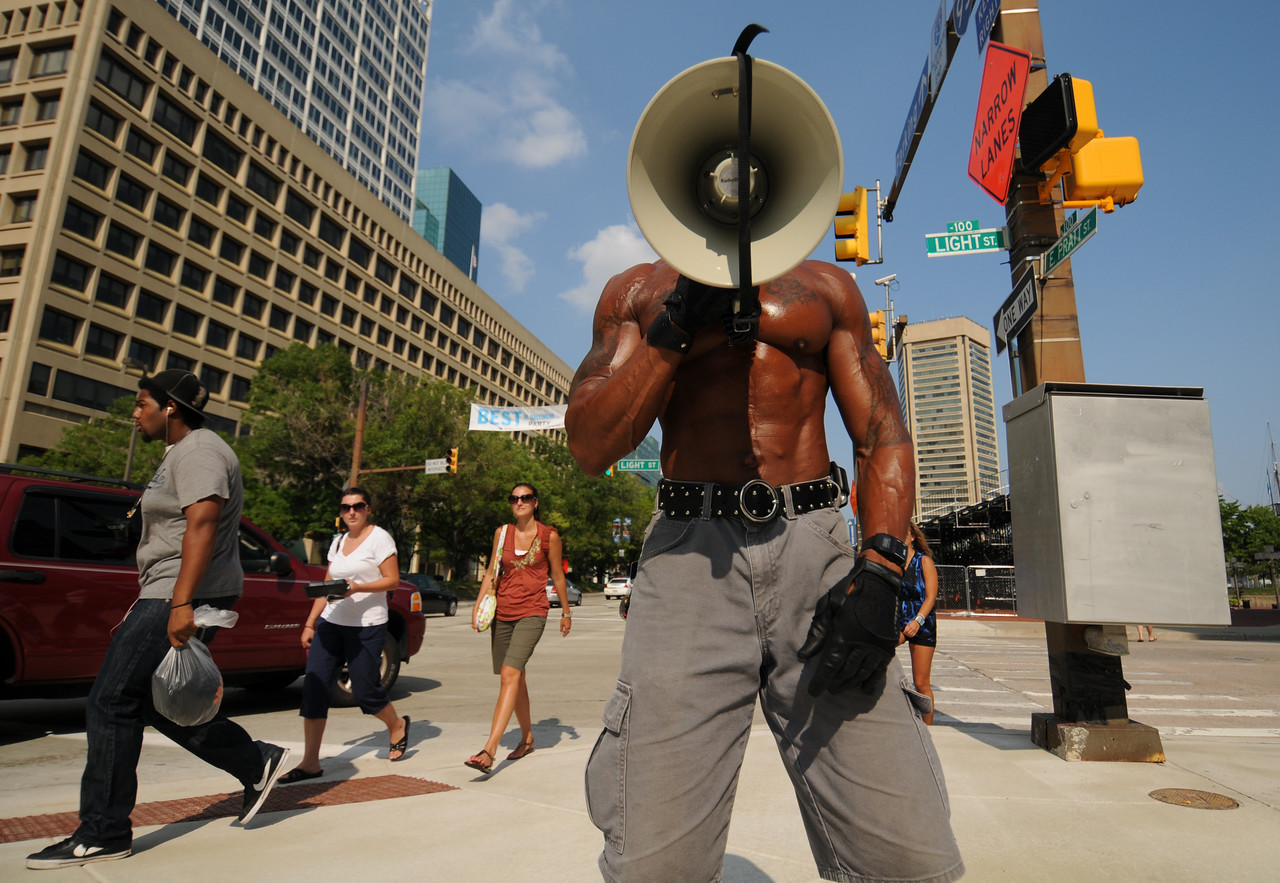 08.08.2011 BALTIMORE, MD- Joshua Anderson, Baltimore resident and street vender, using a mega-phone to sing a rap song about the ice cold water, that he is selling with family members on the corner of Pratt and Light Streets in Downtown Baltimore. (The Daily Record/Maximilian Franz).