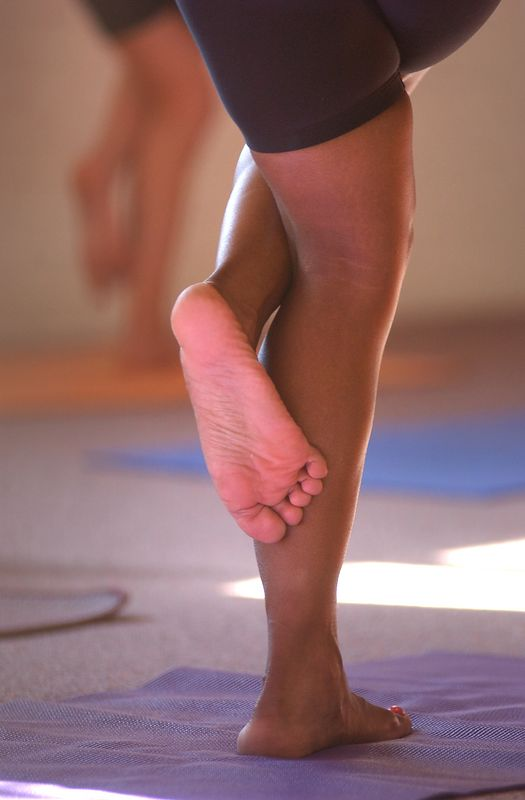 Shots of the HOT yoga class at the Midtown Yoga Studio, that is taught by Katie Thorworth. The Room temperature is set to about 88 degrees to increase flexability. Maximilian Franz/The Daily Record  4/6/04.