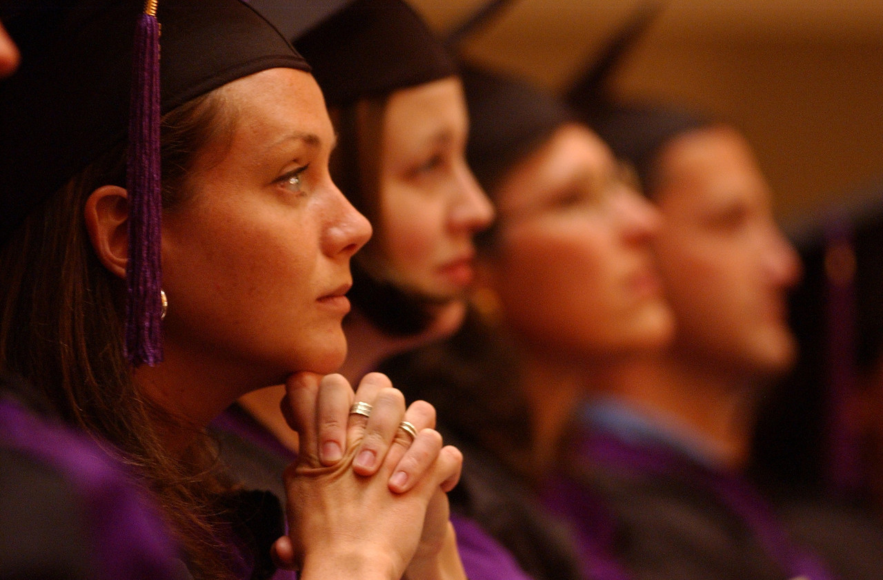 Graduates listening to the guest speaker Kenneth Feinberg, head of the september 11 Victums Fund at the University of MD Law Graduation/ Hooding Ceremony at the Myerhoff Symphony Hall. Maximilian Franz/The Daily Record  5/24/02.