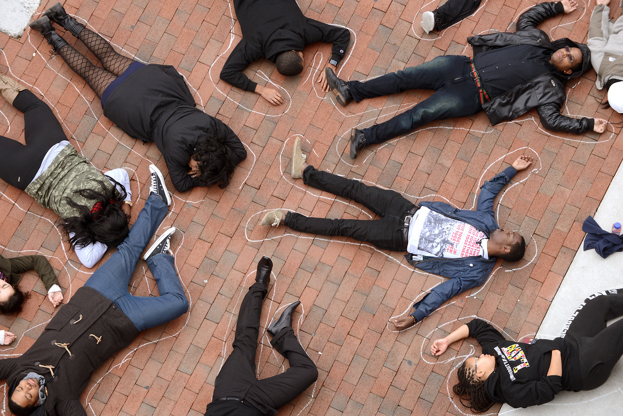 11-25-14 BALTIMORE, MD- A group of students at the University of Baltimore Law School gathered on the campus sidewalk and laid down for the 4 minutes following 11:51 am on Tuesday November 25th, and had their bodies outlined in chalk. They did this to commemorate the 4 hours that Michael Browns body laid in the street after being shot dead and to support his family in peaceful protest. (The Daily Record/Maximilian Franz)