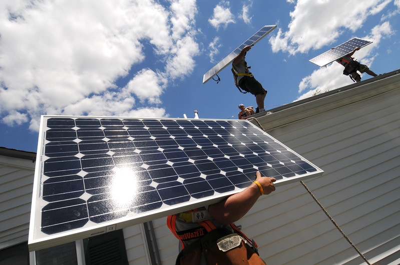 7.2.10- BALTIMORE, MD- Workers from Astrum Solar, a solar installation firm in Maryland, installing a system on the roof of the home of Essex residents Jeff and Michele Manning. Photo by Maximilian Franz/ The Daily Record