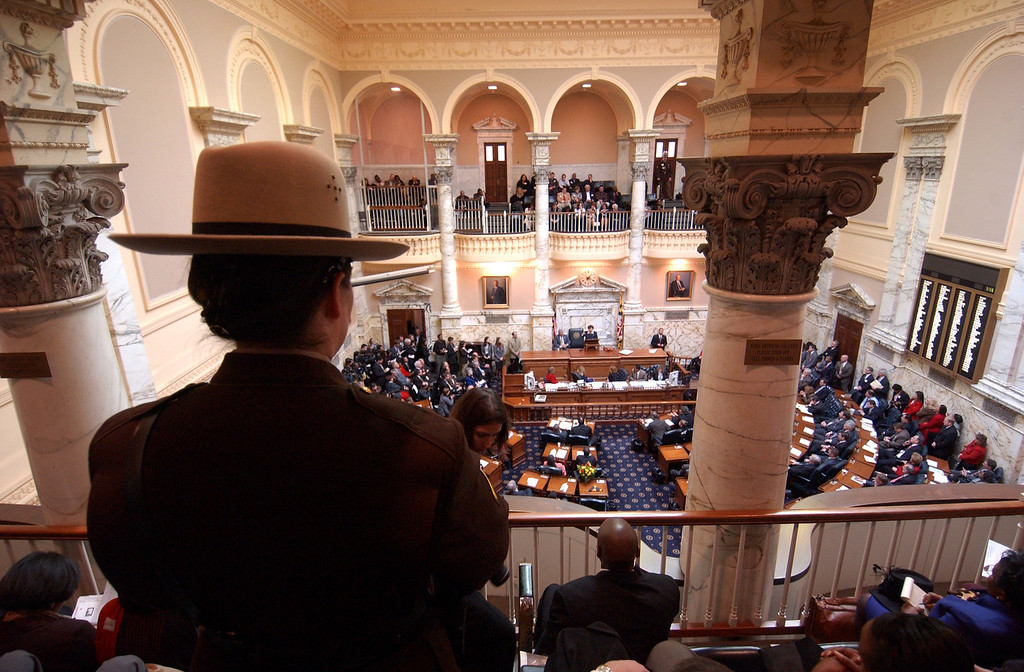A state trooper overlooks the House Chamber in Annapolis during the opening of the Maryland General Assembley in 2004. Maximilian Franz/The Daily Record