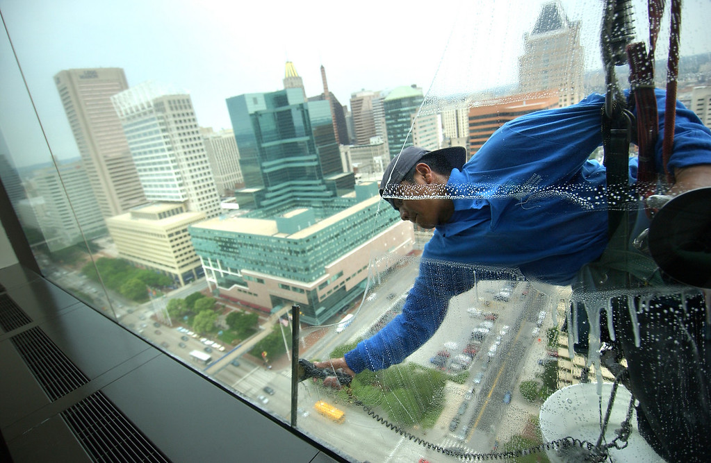 A window washer works his way down the World Trade Center building in Baltimore's Inner Harbor. 6/6/2005 Maximilian Franz/The Daily Record