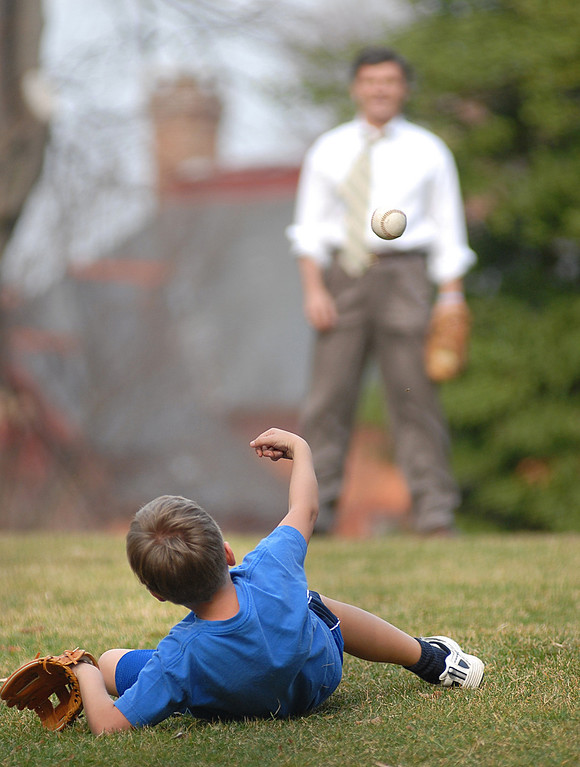 Governor Robert L. Ehrlich, Jr. playing catch with his son Drew on the front lawn of the Governors Mansion. The temp of the day peaked at about 84 degrees making it feel like springtime. MF-D 3/13/06. Maximilian Franz/The Daily Record