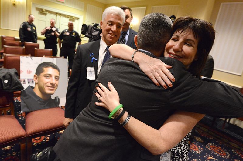 "4.11.2016 ANNAPOLIS, MD- Senator Robert A.""Bobby"" Zirkin, D- Baltimore County, hugs Marcia Goldman, mother of Noah Leotta, a police officer who was killed by a drunk driver, as Noah's fater, Richard Leotta, looks on after a hearing before the final vote on Noah's Law on the final night of the 2016 Maryland General Assembly. (The Daily Record/Maximilian Franz)"