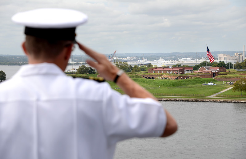 9.10.2014 BALTIMORE, MD- Cdr. Ted Huebner, of Carrier Strike Group B. Salutes the flag at Fort McHenry from the deck of the USS Oak Hill as it sails into Baltimore for the Star-Spangled Spectacular weekend. (The Daily Record/Maximilian Franz)
