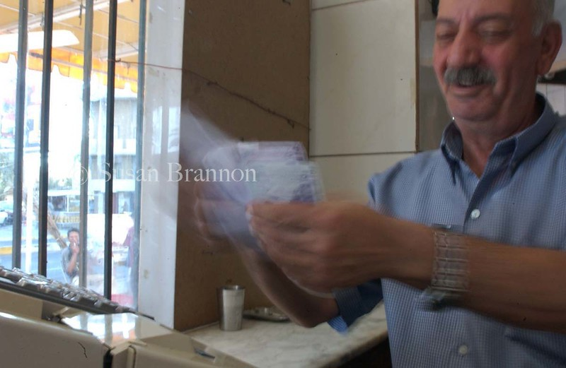 17 Sept. 03 - Baghdad, Iraq - The Iraqi denar drops in value daily while Hassam quickly counts money for his shwarma shop in Baghdad.  The cost for 3 shwarma is 1.50 U.S. dollars about 24 $250 Iraqi bills or 6,000 Iraqi denars.