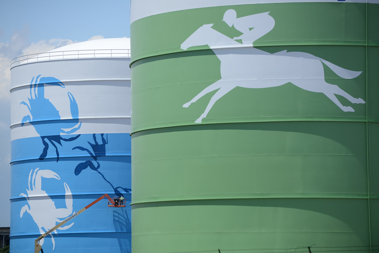 6.7.16 BALTIMORE, MD--The Liquefied Natural Gas tanks at the BGE Spring Gardens facility at the I-95-395 interchange are being painted with iconic Baltimore themed designs in honor of the company's 200th Anniversary. BGE was founded in 1816 as The Gas Light Company of Baltimore and is the oldest Gas utility company in North America. The murals are being painted by G. C. Zamas & Company, Inc. and should be completed for the 200th Celebration on June 17th. (The Daily Record/Maximilian Franz)