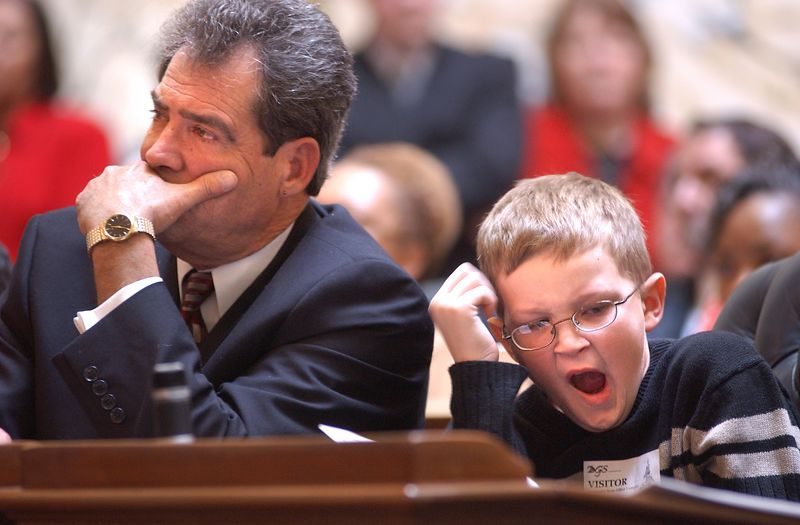 One of the Delegates Grandsons hides a yawn at the opening of the Maryland General Assembley in 2004. Maximilian Franz/The Daily Record