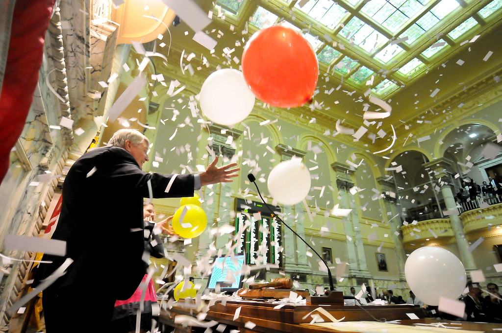 04.11.2011 ANNAPOLIS, MD- Confetti and balloons drop on House Speaker Michael Busch just moments after the closing of the 2011 Maryland General Assembly Session. Photo taken on the closing night of the 2011 Maryland General Assembly at the Statehouse in Annapolis. (The Daily Record/Maximilian Franz).