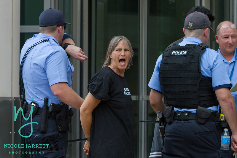 A Protester chants as she is escorted to her arrest at the St. Louis Courthouse on August 10, 2015. Photo Copyright Nicole Jarrett Photography, LLC