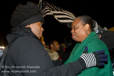 Protesters comfort one another on the evening of the grand jury announcement in the shooting death of Michael Brown by police officer Darren Wilson in Ferguson, Missouri on November 24, 2014. Photo by Nicole Jarrett Alvarado