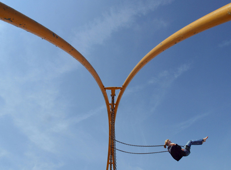 Swinging into the sky on the Eastern Prom in Portland.