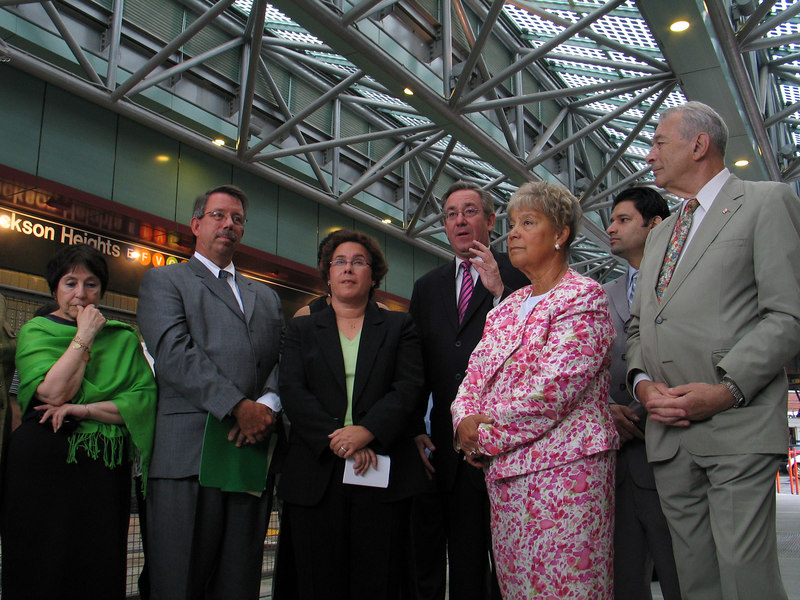 Borough President Helen H. Marshall (in pink), State Senator John D. Sabini (speaking) and other government officials gathered to announce the opening of the Victor Moore Arcade Bus Terminal in Jackson Heights, NY.  Photo © Shams Tarek (shams.m.tarek@gmail.com)