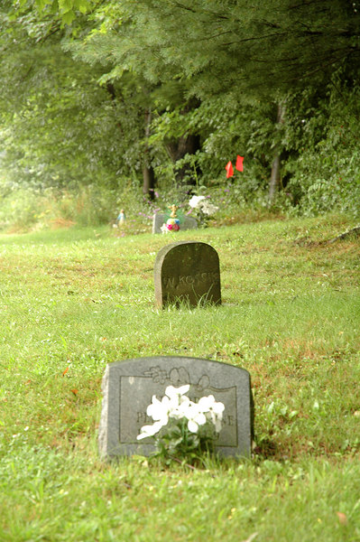 "Infant graves on the edge of St. Michael's Cemetery (on ""unblessed ground"") due to their death prior to baptism.<br /> <br /> Augustine some 1500 years after his death still held sway over the actions of poor coal miners on the other side of the world.  The practice continued in this rural town in Pennsylvania till at least the 1930's.<br /> <br /> Thus, unconscious infants dying without this sprinkling are automatically damned to hellfire because they still have the inherited guilt. --Augustine of Hippo (354-430)"