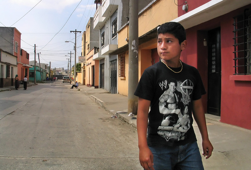 Santos Murcia, 13, walks through his neighborhood, which is near the garbage dump in Guatemala City, on Wednesday, January 24, 2007. Santos participates in Safe Passage's vocational program and wants to be a construction worker. The Safe Passage program helps kids stay off the streets of Guatemala City's poor neighborhoods, where gangs and drugs are rampant.