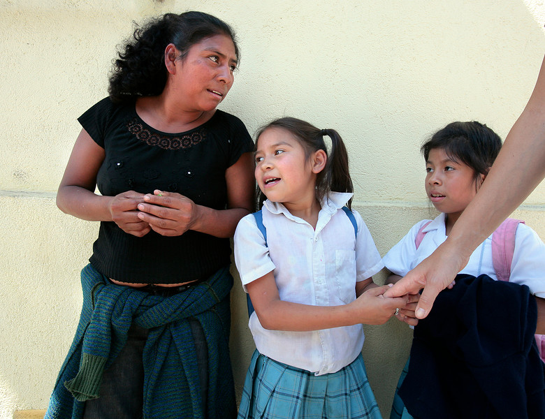 Ingrid Chiche and her daughter Brenda Michelle talk while they wait Brenda's younger sister Valeria to get out of the Safe Passage educationall support program in Guatemala City. All four of Ingrid's children are served by Safe Passage.