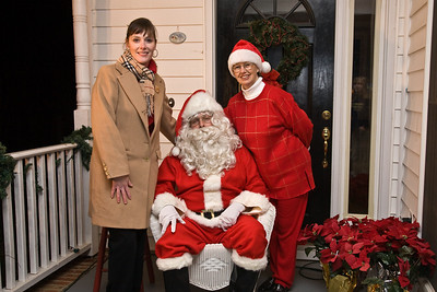 Organizers Geralyn Miller and Sharon Decker pose with Santa.
