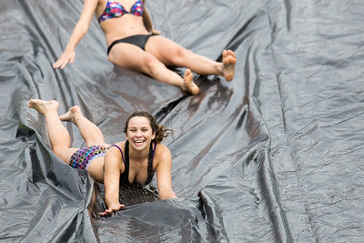 Maddie Scharlemann takes a ride on a slip n' slide students made on campus after the relentless rain over the past few days.