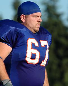 Dan Gough, Intense lineman in skull cap walking off the field