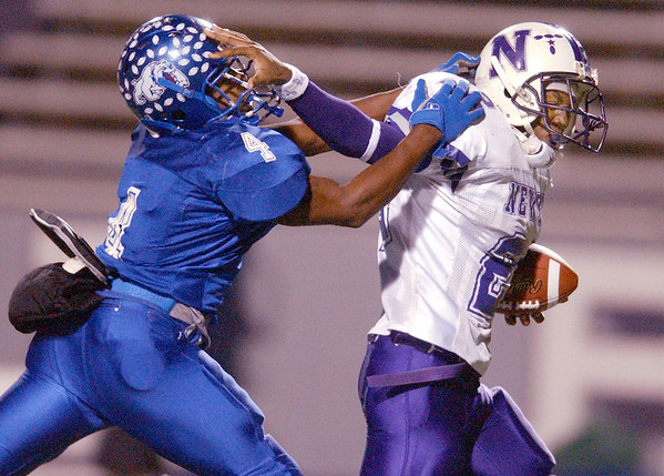 Newton High School running back Toddrick Pendland (22), right, slips away from Quitman High School defensive back Adrian Jackson (4) with less than a minute left in the first quarter Friday night at Bryce Stadium on the Stephen F. Austin State University campus in Nacogdoches during the class 2A Division 1 quarterfinals. Pendland carried the ball about 19 yards for a Newton first down.