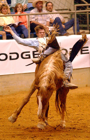 Clay Bunney, of Snyder, TX, takes a wild ride Friday night during the bare back bronc event of the YMBL Rodeo at Fair Park Coliseum. Bunney earned a score of 66 for his ride. The 58th annual rodeo cntinues tonight at 7:30 p.m. Gates open at 6:00 p.m.<br /> PHOTO/SCOTT ESLINGER                  MAY 2, 2003