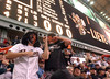 "As the crowd sings ""I Bee-lieve"" Denver Williams, 23, left, and Derrick Brannon, 22, both of Groves, dance in the outfield stands under the scoreboard in the bottom of the eight inning at Minute Maid Park during game three of the World Series against the Chicago White Sox.<br /> PHOTO/SCOTT ESLINGER            OCT 25, 2005"