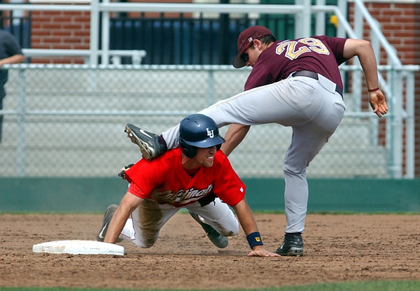 Lamar University's Jojo Haney (13), left, gets tangled up with Louisiana-Monroe second baseman Travis Drader (29) in the bottom of the sixth inning as Drader unsuccessfully tries to get him picked off Sunday afternoon at Vincent-Beck Stadium. The Cardinals lost to the Louisiana-Monroe Indians 10-5.<br /> PHOTO/SCOTT ESLINGER                    APRIL 23, 2006<br /> 0423_LamarBaseball02.jpg