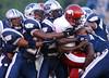 The West Orange-Stark High School defense wraps up Jasper quarterback Gilbert Moye (1) early in the first quarter Friday night at Mustang Stadium in Orange.<br /> PHOTO/SCOTT ESLINGER             AUGUST 27, 2004