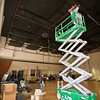 Wilbert Fergeson (top) and Anne Taylor install lighting fixtures in the new theater space.
