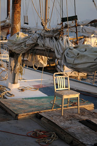 """A lone chair basks in the early morning light on the deck of The City of Christfield, Owed and operated by Captain Arthur """"Daddy Art"""" Daniels, Jr., winner of the race 6 out of the 7 past years. Photo By Maximilian Franz 9-07-09"""