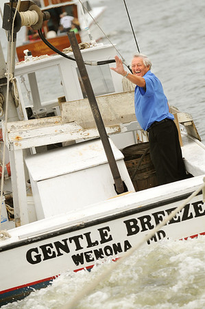 The captain of the 'Gentle Breeze' crabbing boat waves back to the passangers on the 'City of Chrifield'. Photo By Maximilian Franz 9-07-09