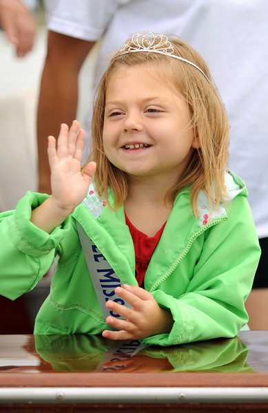 """Five year old Little Miss Skipjack, Mekenna Paige Horner, cruised by in a motor yacht wishing Daddy Art and the crew of the """"City of Crisfield' good luck . Photo By Maximilian Franz 9-07-09"""