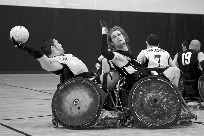 Austin attempts to block a pass during a wheelchair rugby match against the Denver Harlequins.