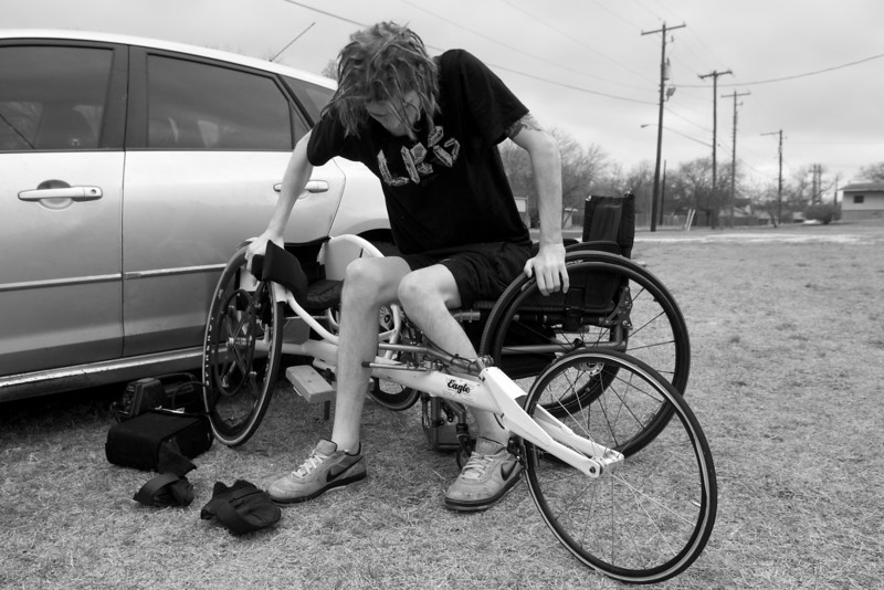 Moving from his regular wheelchair to his racing wheelchair can be a challenge, but Austin handles it with ease.