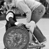 Austin's girlfriend Lindsey hops on for a ride during a wheelchair rugby practice.