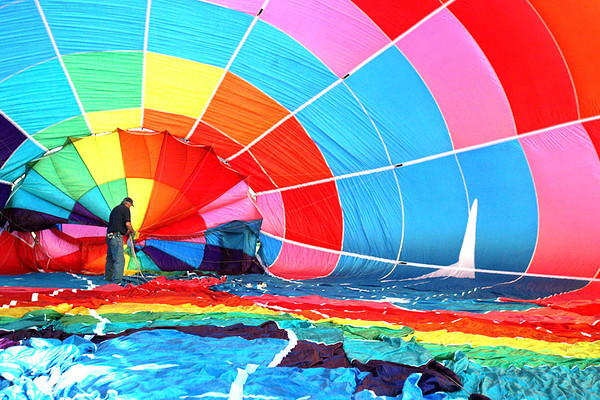 """Chris Ammann/Baltimore Examiner Bob Dicks of Buck County, Pa. straightens out the lines of his hot air balloon """"Fleck Folly IV"""" during Preakness Balloon Fest at Oregon Ridge Park in Timonium on Thursday, May 18, 2006."""