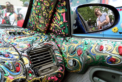 Amy Brusselback, reflected at right, of Baltimore, looks at the art car of H Karl Schlatter on display during Artscape in Baltimore on Sunday, July 2, 2007. Chris Ammann/Examiner