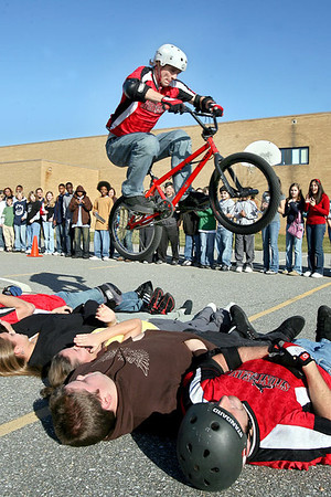 Chris Ammann/Baltimore Examiner BMX biker Lane George jumps over four Patuxent Valley Middle School students and two of his companion riders during a BMX demonstration at the school on Thursday, Jan. 4, 2007 in Jessup.