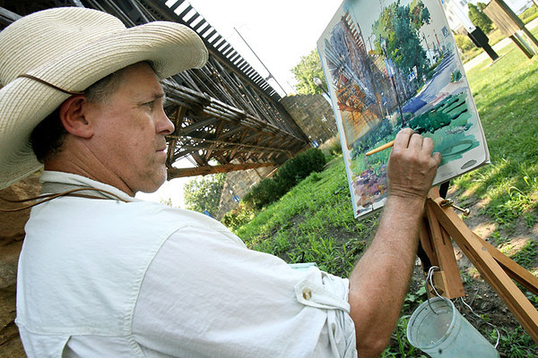 Artist Stewart White, of Baltimore, paints with watercolor under the railroad tracks at Jean S. Roberts Memorial Park as part of the Havre de Grace Plein Air Painting Competition on Thursday, Aug. 2, 2007. Chris Ammann/Examiner