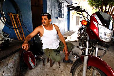 Antonio Quinonez is a motorcycle repairman in La Gomera, Guatamala.  Photo by Kyle Spradley | www.kspradleyphoto.com