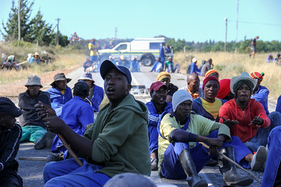Striking farm workers sit in protest on N7 for an increase in minimum wages